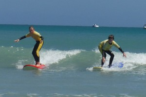 siblings learning their surf lessons